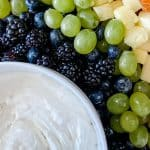 Rainbow fruit tray with white cream cheese fruit dip