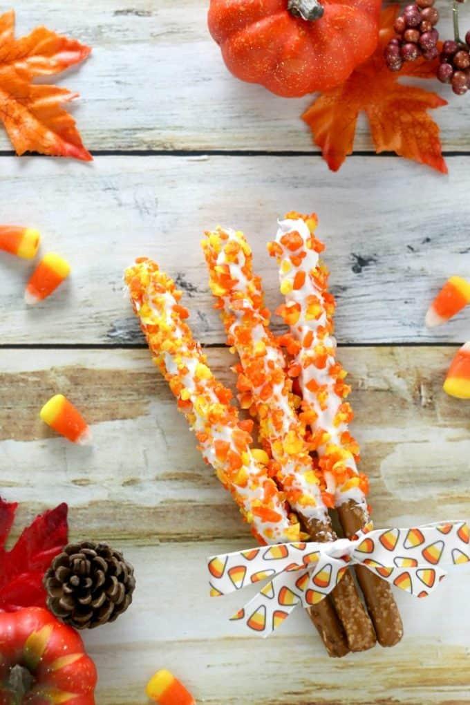 candy corn themed chocolate covered pretzel sticks