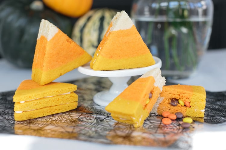 triangle cut cookies with yellow, orange, and white layers