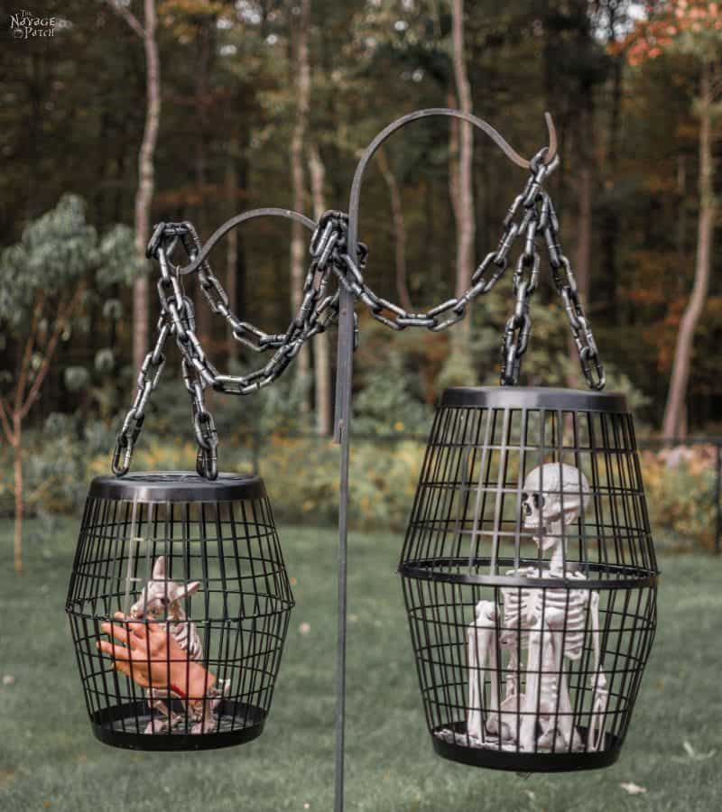 laundry baskets made into cages with fake skeletons inside