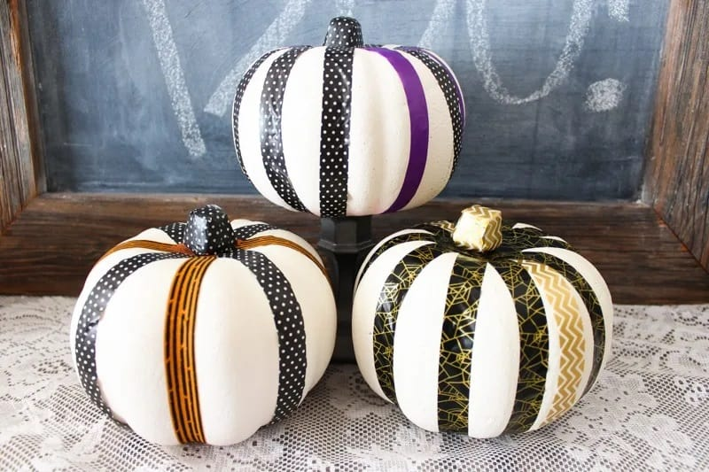 white pumpkins with Halloween themed ribbon